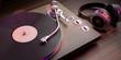 Leinwandbild Motiv Headphones and vinyl LP record player on wooden background, closeup view. 3d illustration