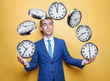 Businessman juggles for hours. The clock shows an eight-hour day