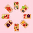 Healthy eating. Fresh vegetables on wooden chopping boards isolated on pink background