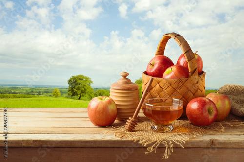 Leinwanddruck Bild Honey and apples on wooden table