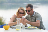 couple on holiday eating breakfast - 216430354