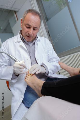 Canvas Pedicure podiatrist cleaning womans feet