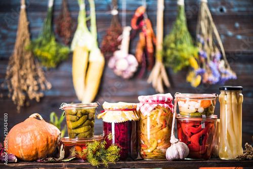 Leinwanddruck Bild Pickled Marinated Fermented vegetables on shelves