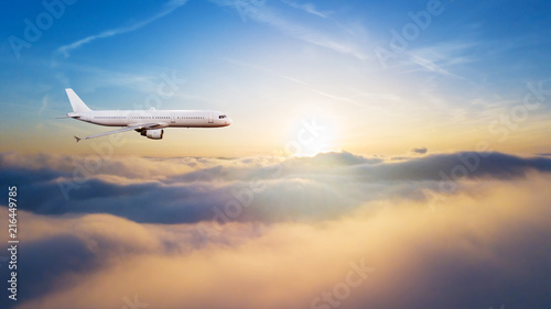 Foto Spatwand Zonsopgang Detail of commercial airplane flying above clouds