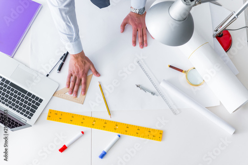Engineer working on new project drawings