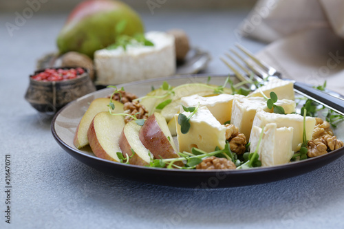 Foto Murales Camembert cheese with pear and fragrant herbs