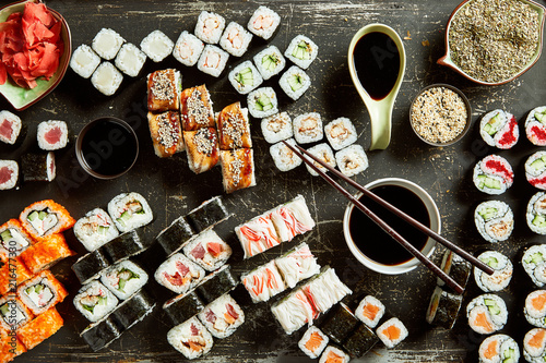 Foto Spatwand Sushi bar High angle view of variety of sushi server with sauces