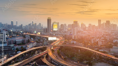 In de dag Bangkok Aerial view highway interchange in city downtown sunset tone, cityscape background