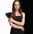 pretty woman with long brown hair in black dress