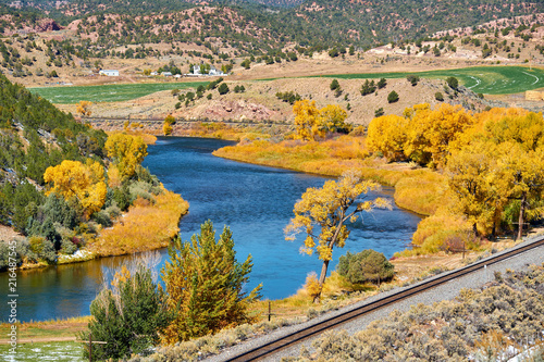 Foto Spatwand Honing Landscape with autumn trees and river