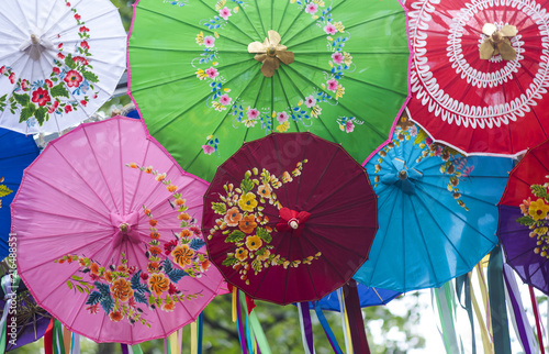 Colorfull Malasian Asian Umbrellas with Flowers on the Top © Savvapanf Photo ©