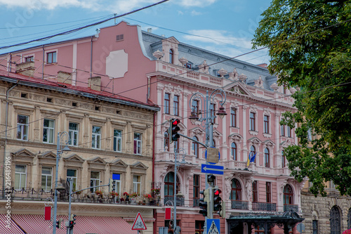 Foto Murales Old house in city. View on old street city in Ukraine. Road signs on the street