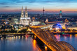 Leinwandbild Motiv Köln Skyline mit Kölner Dom und Hohenzollernbrücke bei Nacht