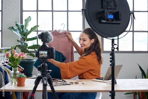 Fashion influencer vlogger creating videos for her channel