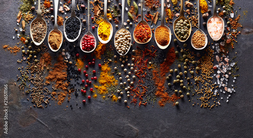 Spices on black graphite board © Dionisvera