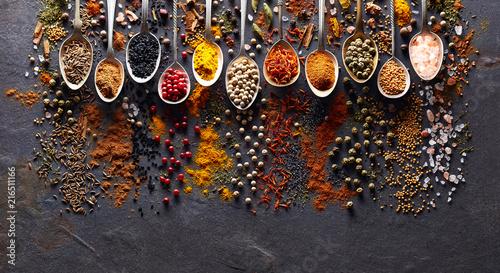 Spices on black graphite board © Dionisvera