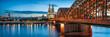 Leinwanddruck Bild - Skyline von Köln mit Kölner Dom und Hohenzollernbrücke bei Nacht