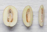 Melon slices on white wooden background, top view. From above, flat lay. Closeup. - 216536514