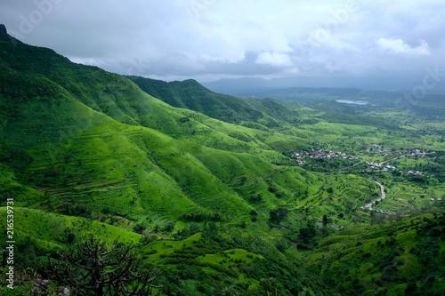 Foto Spatwand Blauwe hemel Lush green monsoon nature landscape mountains, hills, Purandar, Pune, Maharashtra, India