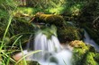 Waterfalls in the natural park of the birth of Río Cuervo, in the mountains of Cuenca, Spain - 216549152