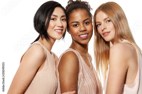 Leinwanddruck Bild Portrait of three different nation women asian african-american and caucasian are brought together with diverse type on skin. Isolated on white background
