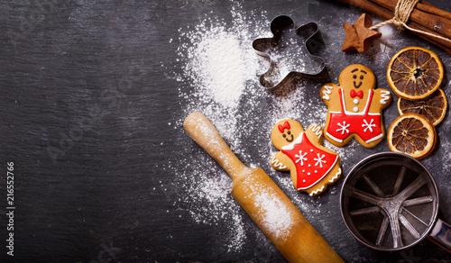 Leinwandbild Motiv Christmas food. Gingerbread cookies with ingredients for christmas baking