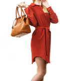 Female wearing red dress holding bag - 216563133