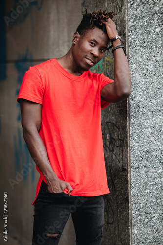 Foto Murales African man in red t-shirt at urban city place