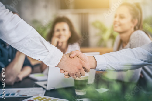 Business people shaking hands. Finishing up meeting.