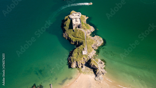 Leinwandbild Motiv Aerial drone view of an old, historic fort on a small island off a picturesque, colorful coastal town (St Catherine, Tenby)