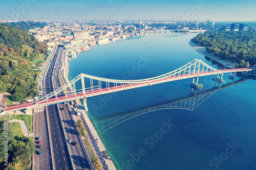 Canvas Kiev The city of Kiev. Dnieper. Aerial view of District of Podil and the Pedestrian bridge