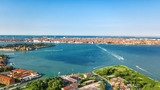 Aerial view of Venetian lagoon and cityscape of Venice island in sea from above, Italy  - 216597906