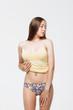 Woman in underwear crumpling top