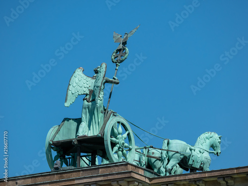 The Quadriga of Brandenburg Gate Against A Blue Sky In Berlin, Germany © cbies