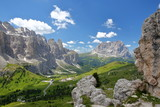 Sella Group mountains (on the left) and Sassolungo mountain (on the right) viewed from a hiking path in Puez Odle Natural Park, Val Gardena, Dolomites, Italy