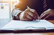 Leinwandbild Motiv Business man sign a contract investment professional document agreement.