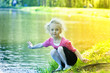 Leinwanddruck Bild - young blonde girl in summer at the lake
