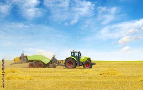 Fotobehang Trekker tractor on field