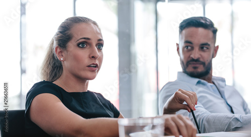 Female executive talking in strategy meeting