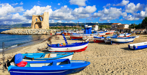 Fotobehang Freesurf Traditional fishing village Briatico in Calabria with colorful boats and old saracen tower. Italy
