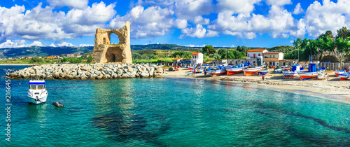 Fotobehang Freesurf Traditional fishing village Briatico in Calabria with turquoise sea and old saracen tower. Italy