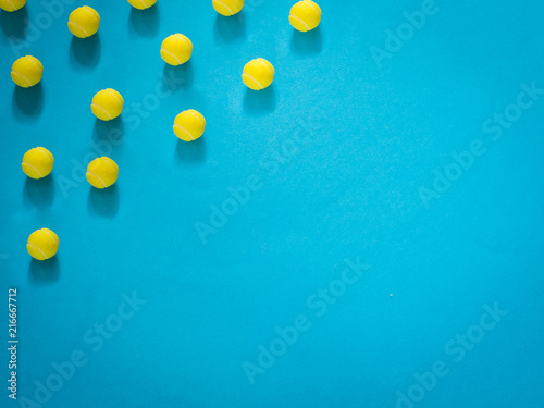 Aluminium Tennis Yellow tennis ball on blue background with copy space