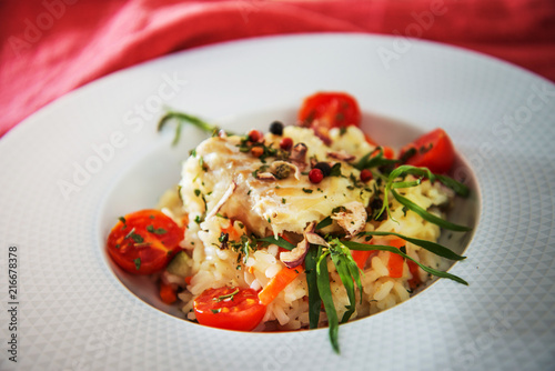 Andalusian fish, saffron rice with vegetables - 216678378