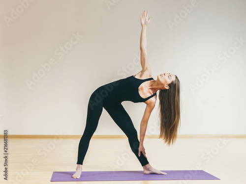 Sticker Young woman stretching at gym