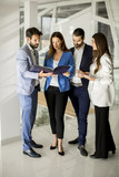 Young business people standing and analyzing documents