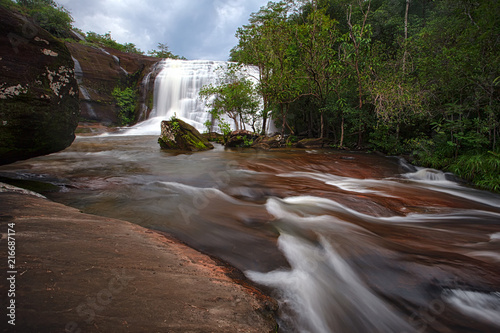 Namtok Chet Si Waterfalls , this waterfall comes from a stream of Huai Ka-am and flows along a high sandstone cliff spreading over a long line. The fall of the water causes - 216687174