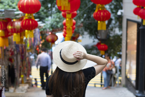 Foto Murales Tourist is walking and traveling on the street in Hong Kong travel district with decoration by Chinese lanterns beautiful sign.