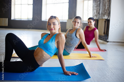 Leinwandbild Motiv rest time, interval workout, activity, healthy lifestyle, sport, weight loss, tabata. Group of women respite on mats between exercise sets