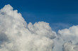 Fluffy White Clouds Against Blue Background - 216702165