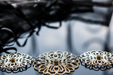 Gold jewelry is yellow and different shades. Jewelry from metal alloy with openwork patterns on the reflective surface. Stylish and fashionable design.